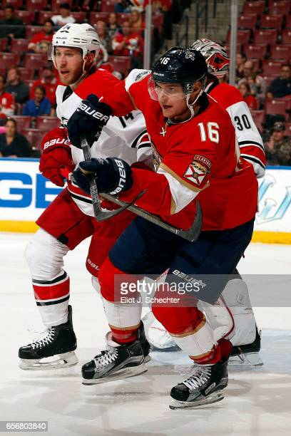 Aleksander Barkov of the Florida Panthers skates for possession against Jaccob Slavin of the Carolina Hurricanes at the BBT Center on March 21 2017...