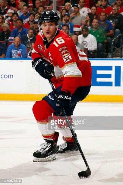 Aleksander Barkov of the Florida Panthers skates for possession against the New York Rangers at the BBT Center on December 8 2018 in Sunrise Florida