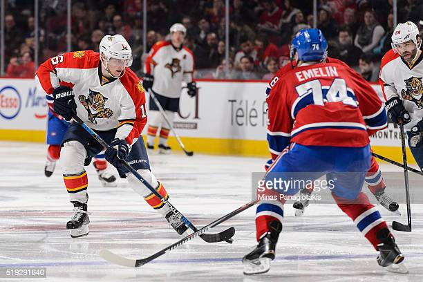 Aleksander Barkov of the Florida Panthers skates the puck against Alexei Emelin of the Montreal Canadiens during the NHL game at the Bell Centre on...