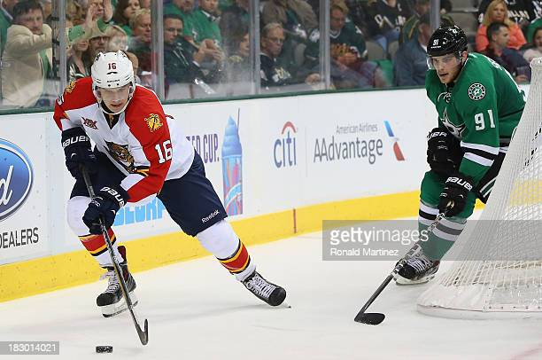 Aleksander Barkov of the Florida Panthers skates the puck past Tyler Seguin of the Dallas Stars in the third period at American Airlines Center on...