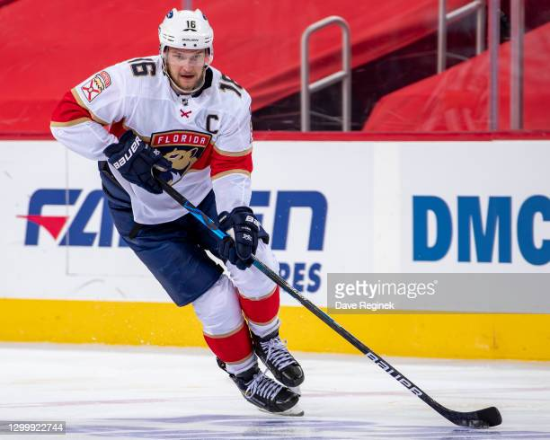 Aleksander Barkov of the Florida Panthers skates up ice with the puck during an NHL against the Detroit Red Wings game at Little Caesars Arena on...