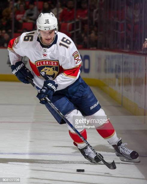 Aleksander Barkov of the Florida Panthers skates up ice with the puck against the Detroit Red Wings during an NHL game at Little Caesars Arena on...