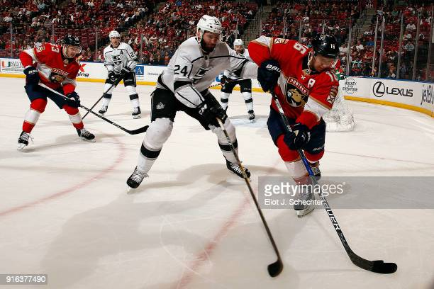 Aleksander Barkov of the Florida Panthers skates with the puck against Derek Forbort of the Los Angeles Kings at the BBT Center on February 9 2018 in...