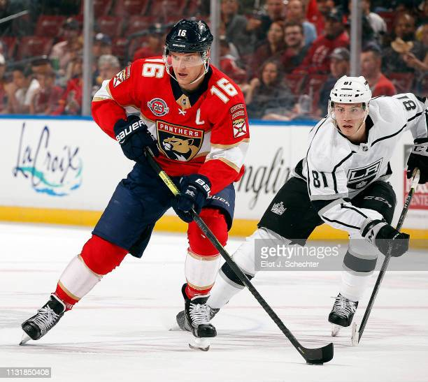 Aleksander Barkov of the Florida Panthers skates with the puck against Matt Roy of the Los Angles Kings at the BBT Center on February 23 2019 in...