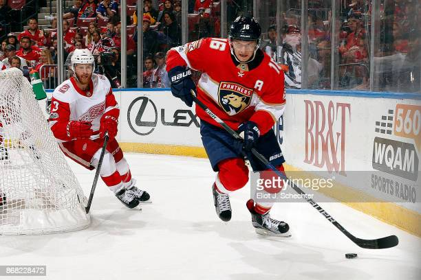 Aleksander Barkov of the Florida Panthers skates with the puck against Nick Jensen of the Detroit Red Wings at the BBT Center on October 28 2017 in...