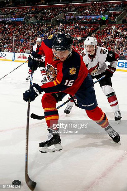 Aleksander Barkov of the Florida Panthers skates with the puck against Connor Murphy of the Arizona Coyotes at the BBT Center on February 25 2016 in...