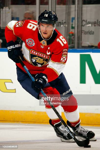 Aleksander Barkov of the Florida Panthers skates with the puck against the Columbus Blue Jackets at the BBT Center on October 11 2018 in Sunrise...