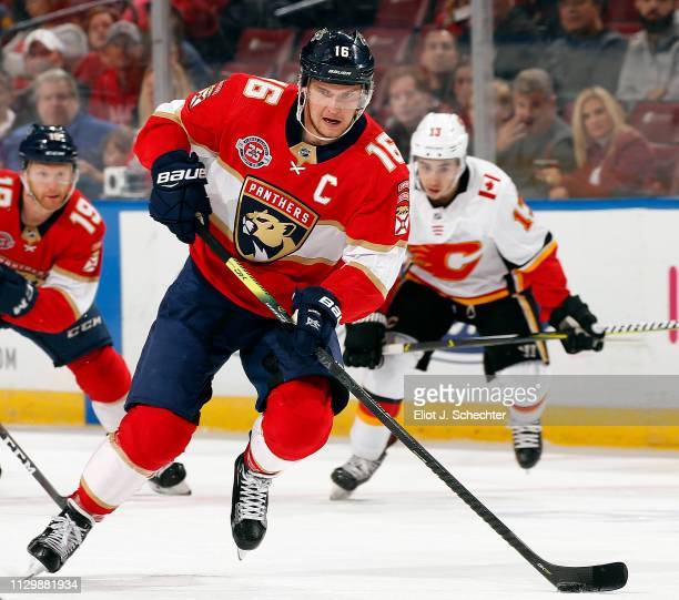 Aleksander Barkov of the Florida Panthers skates with the puck against the Calgary Flames at the BBT Center on February 14 2019 in Sunrise Florida