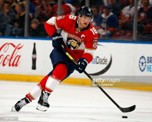 Aleksander Barkov of the Florida Panthers skates with the puck against the New York Islanders at the BB&T Center on December 12, 2019 in Sunrise,...