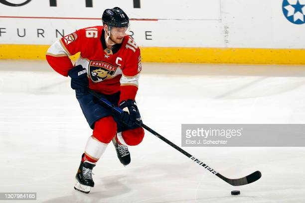Aleksander Barkov of the Florida Panthers skates with the puck against the Nashville Predators at the BB&T Center on March 18, 2021 in Sunrise,...