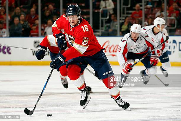 Aleksander Barkov of the Florida Panthers skates with the puck against the Washington Capitals at the BBT Center on October 20 2016 in Sunrise Florida