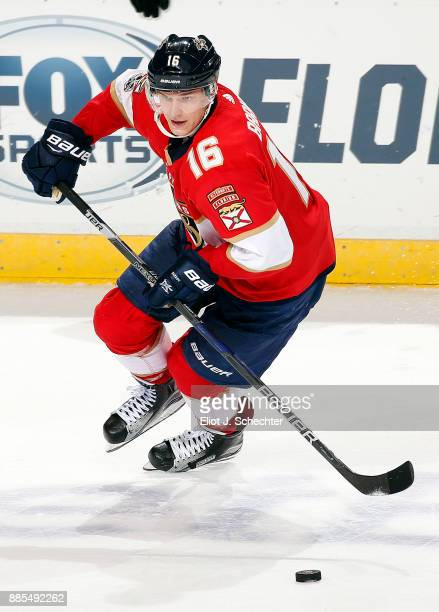 Aleksander Barkov of the Florida Panthers skates with the puck against the San Jose Sharks at the BBT Center on December 1 2017 in Sunrise Florida