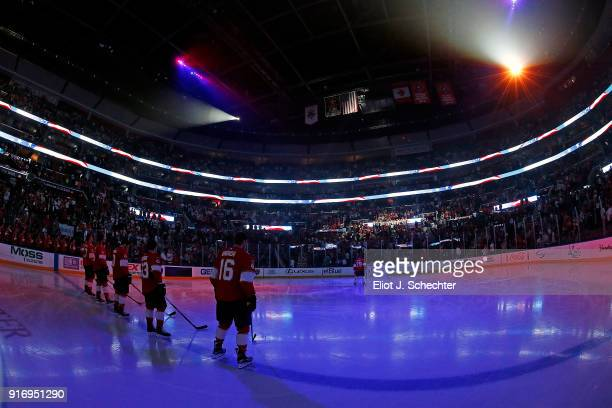 Aleksander Barkov of the Florida Panthers stands for the national anthem with teammates prior to the start of the game against the Los Angeles Kings...