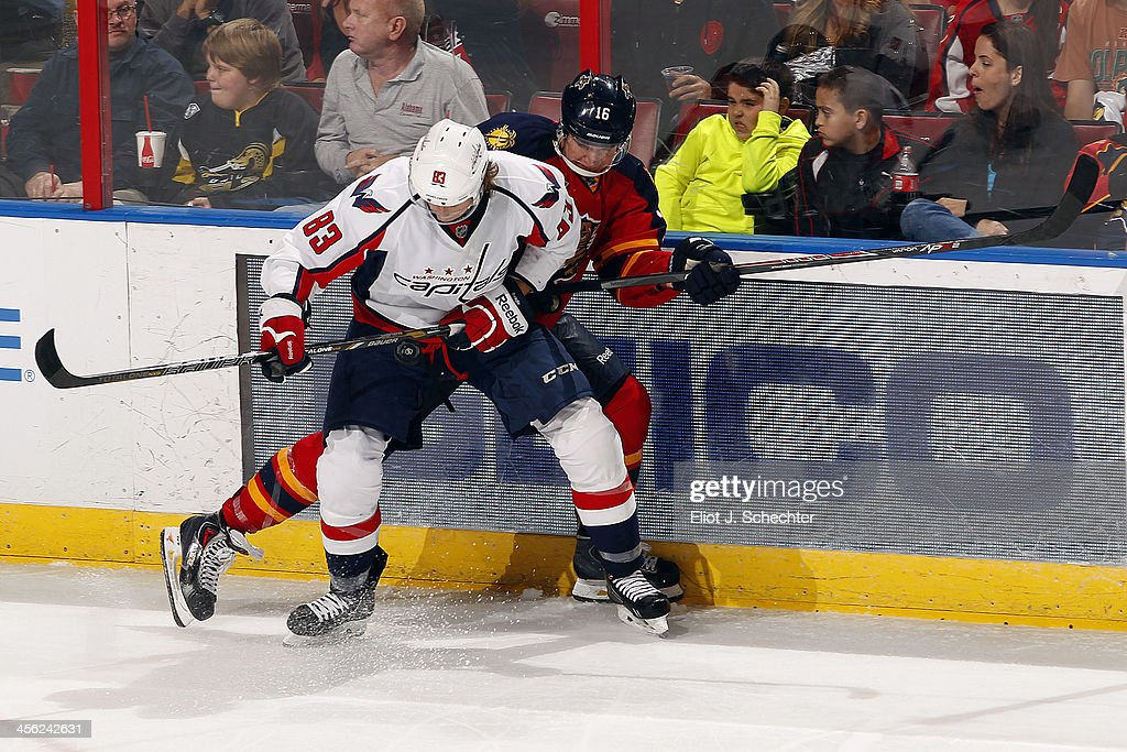 Aleksander Barkov #16 of the Florida Panthers tangles with Jay Beagle #83 of the Washington Capitals at the BB&T Center on December 13, 2013 in Sunrise, Florida.
