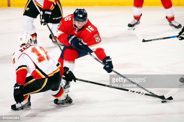 Aleksander Barkov of the Florida Panthers tangles with Mikael Backlund of the Calgary Flames at the BBT Center on February 24 2017 in Sunrise Florida