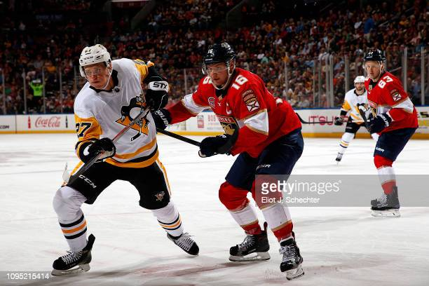 Aleksander Barkov of the Florida Panthers tangles with Nick Bjugstad of the Pittsburgh Penguins at the BBT Center on February 7 2019 in Sunrise...