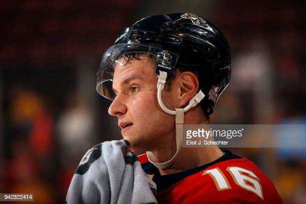 Aleksander Barkov of the Florida Panthers towels off on the ice during warm ups prior to the start of the game against the Nashville Predators at the...