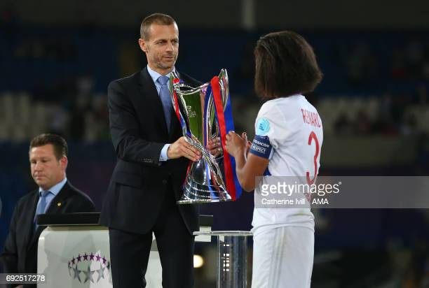 Aleksander Ceferin President of UEFA hands the trophy to Wendi Renard of Olympique Lyonnais during the UEFA Women's Champions League Final match...
