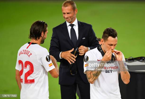 Aleksander Ceferin UEFA President hands a winners medal to Franco Vazquez of Sevilla FC after the UEFA Europa League Final between Seville and FC...