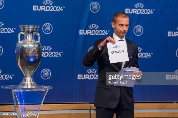 Aleksander Ceferin UEFA president shows the slip of Germany during the UEFA EURO 2024 Host Announcement Ceremony on September 27 2018 in Nyon...