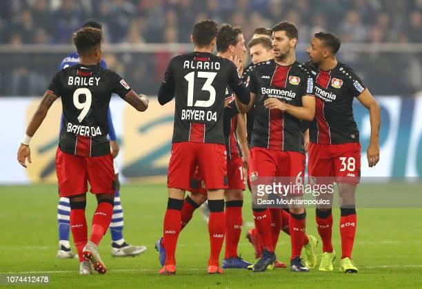 Aleksander Dragovic of Bayer 04 Leverkusen celebrates with teammates after scoring his team's first goal during the Bundesliga match between FC...