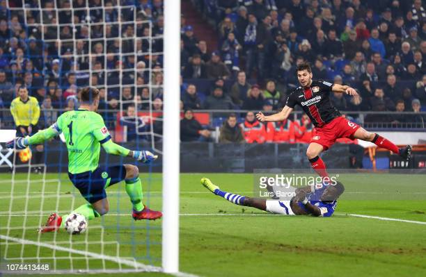 Aleksander Dragovic of Bayer 04 Leverkusen scores his team's first goal past Ralf Faehrmann of FC Schalke 04 during the Bundesliga match between FC...