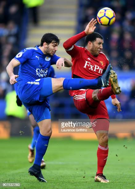 Aleksander Dragovic of Leicester City and Troy Deeney of Watford battle for the ball during the Premier League match between Leicester City and...