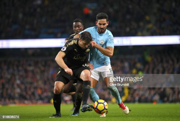 Aleksander Dragovic of Leicester City battles for possesion with Ilkay Gundogan of Manchester City during the Premier League match between Manchester...