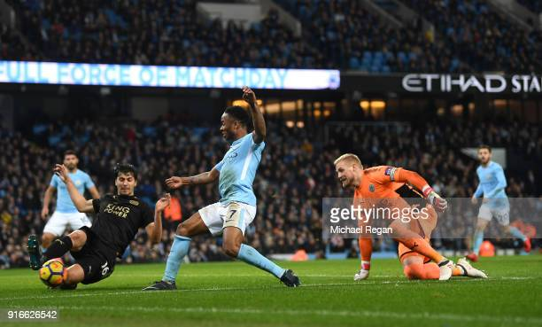 Aleksander Dragovic of Leicester City blocks Raheem Sterling of Mancheste City shot during the Premier League match between Manchester City and...