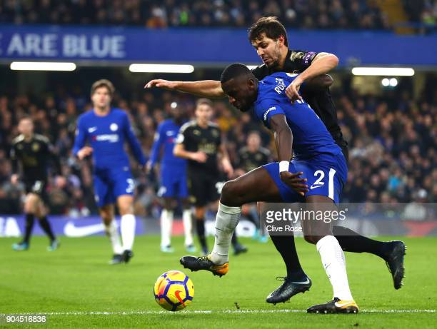 Aleksander Dragovic of Leicester City challenges Antonio Rudiger of Chelsea during the Premier League match between Chelsea and Leicester City at...