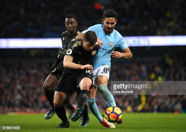 Aleksander Dragovic of Leicester City is challenged by Ilkay Gundogan of Manchester City during the Premier League match between Manchester City and...