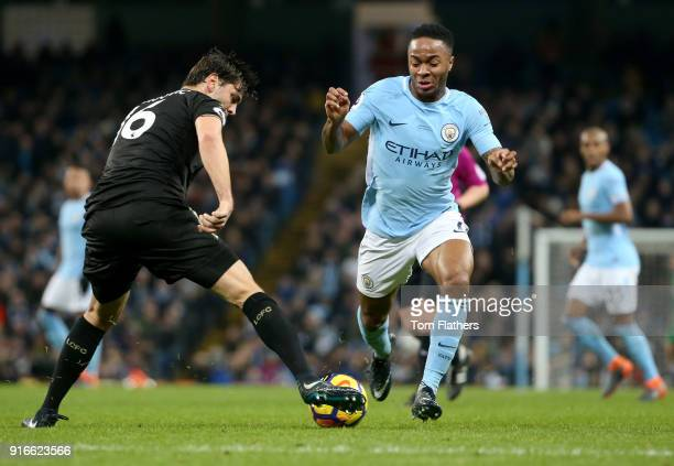 Aleksander Dragovic of Leicester City tackles Raheem Sterling of Manchester City during the Premier League match between Manchester City and...