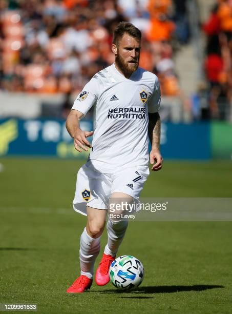 Aleksander Katai of Los Angeles Galaxy brings the ball up field against the Houston Dynamo at BBVA Stadium on February 29 2020 in Houston Texas
