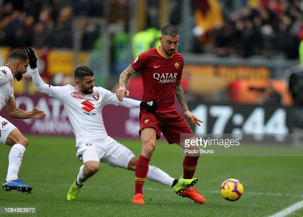 Aleksander Kolarov of AS Roma competes for the ball with Iago Falque of Torino FC during the Serie A match between AS Roma and Torino FC at Stadio...