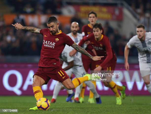 Aleksander Kolarov of AS Roma scores the team's second goal from penalty spot during the Serie A match between AS Roma and FC Internazionale at...