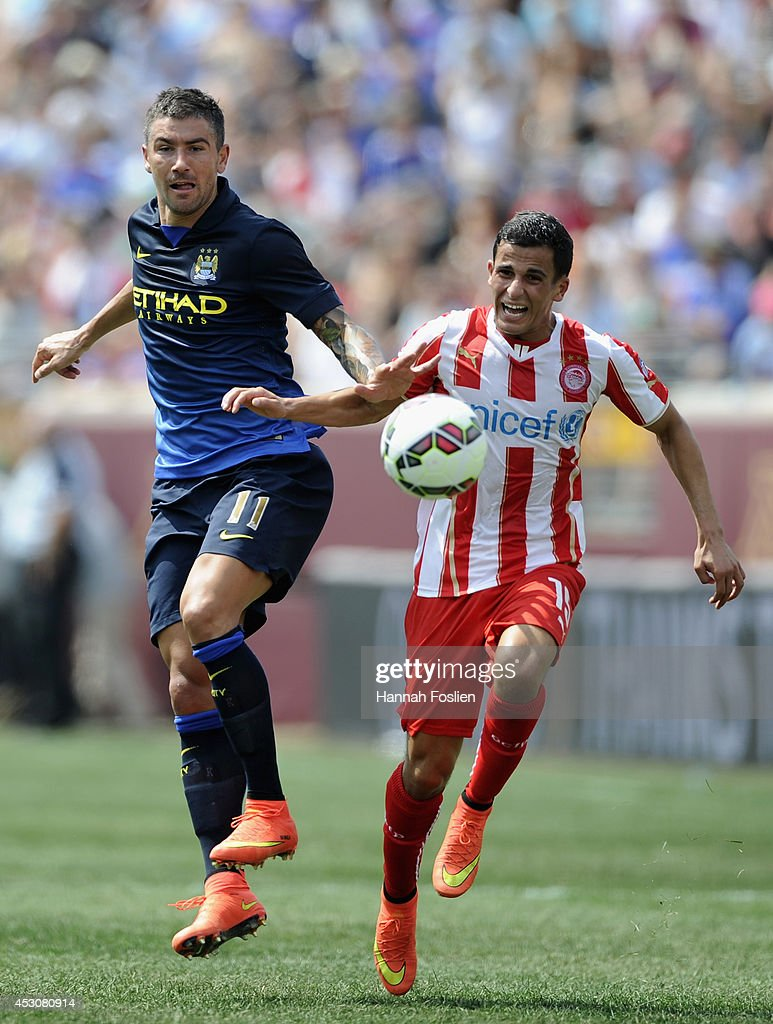 Aleksander Kolarov #11 of Manchester City and Omar Elabdellaoui #15 of Olympiacos chase after the ball during the first half of the International Champions Cup match on August 2, 2014 at TCF Bank Stadium in Minneapolis, Minnesota.