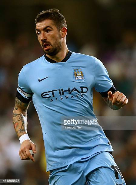 Aleksander Kolarov of Manchester City in action during the friendly match between Hamburg SV and Manchester City at Hazza bin Zayed Stadium on...