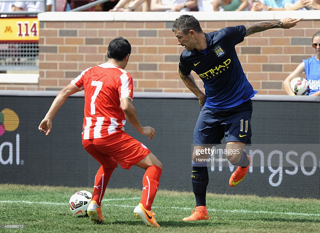 Aleksander Kolarov #11 of Manchester City passes the ball away from Javier Saviola #7 of Olympiacos during the first half of the International Champions Cup match on August 2, 2014 at TCF Bank Stadium in Minneapolis, Minnesota. The Olympiacos defeated the Manchester City in a penalty shootout.