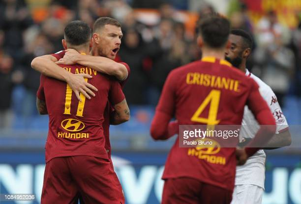 Aleksander Kolarov with his teammate Edin Dzeko of AS Roma celebrates after scoring the team's second goal from penalty spot during the Serie A match...