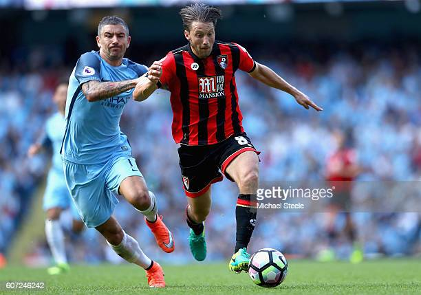 Aleksander Kolorov of Manchester City and Harry Arter of AFC Bournemouth battle for possession during the Premier League match between Manchester...