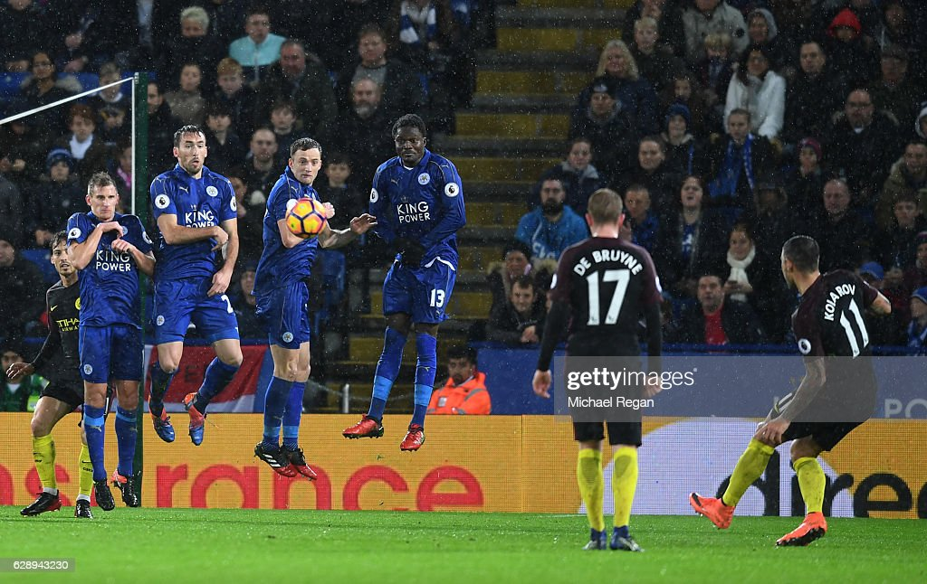 Aleksander Kolorov of Manchester City (R) scores his sides first goal during the Premier League match between Leicester City and Manchester City at the King Power Stadium on December 10, 2016 in Leicester, England.