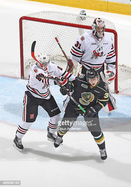 Aleksander Mikulovich of the Niagara IceDogs battles against Julius Bergman of the London Knights during an OHL game at Budweiser Gardens on February...