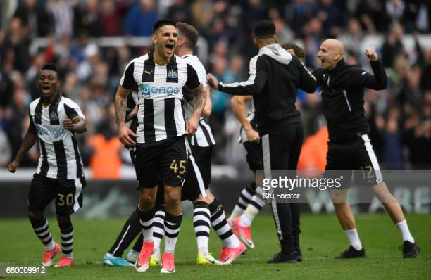 Aleksander Mitrovic and team mates of Newcastle celebrate after hearing the score from the Brighton game means that they win the the Sky Bet...