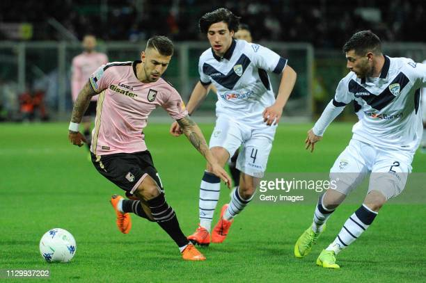 Aleksander Trajkovski of Palermo holds off the challenge from Sandro Tonali of Brescia during the Serie B match between US Citta di Palermo and...