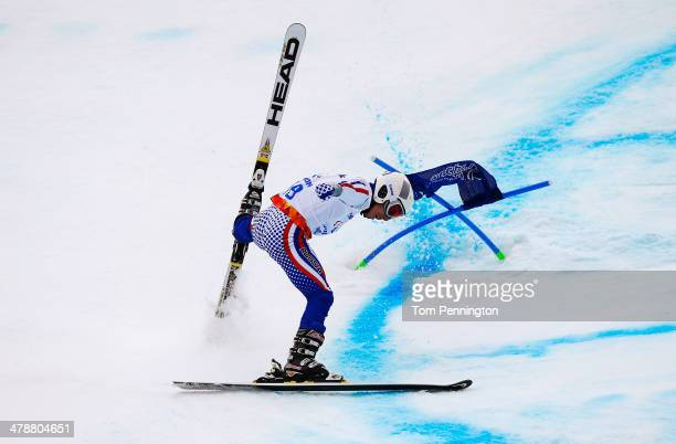 Aleksandr Akhmadulin of Russia crashes in the Men's Giant Slalom Standing during day eight of the Sochi 2014 Paralympic Winter Games at Rosa Khutor...