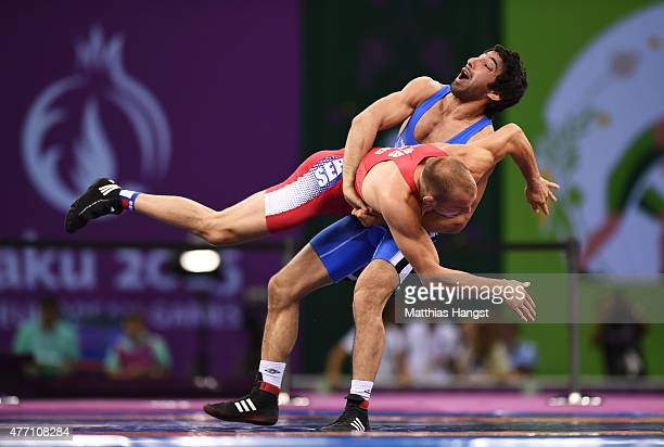 Aleksandr Aksimovic of Serbia and Hasan Aliyev of Azerbaijan compete in the Men's Wrestling 66kg Greco Roman bronze final during day two of the Baku...