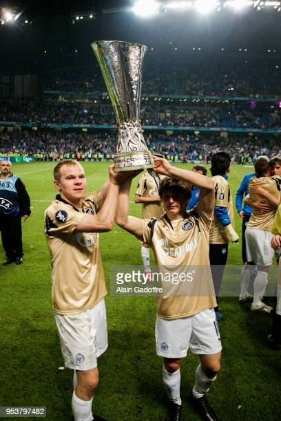 Aleksandr Anyukov and Andrei Arshavin of Zenit celebrates his victory with the trophy during the UEFA Cup Final match between Zenit Saint Petersburg...