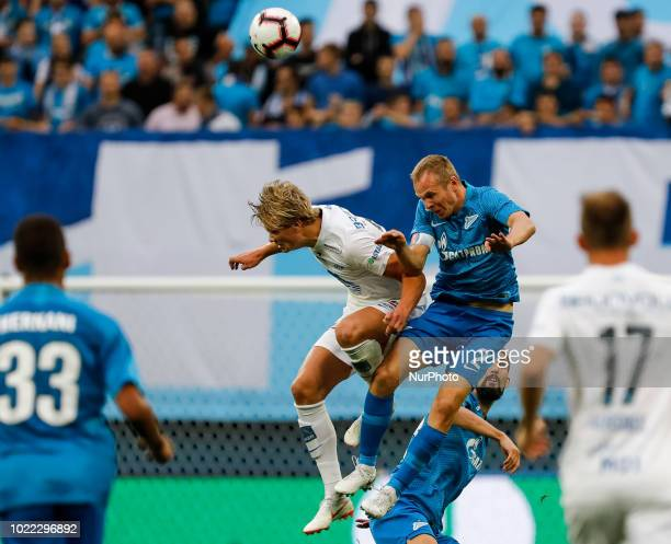Aleksandr Anyukov of FC Zenit Saint Petersburg and Erling Braut Haland of Molde FK vie for a header during the UEFA Europa League playoffs first leg...