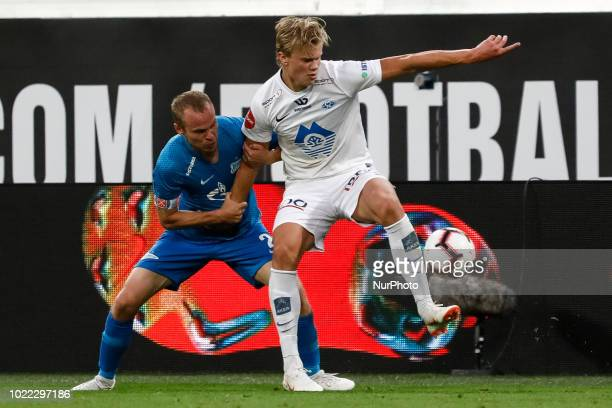 Aleksandr Anyukov of FC Zenit Saint Petersburg and Erling Braut Haland of Molde FK vie for the ball during the UEFA Europa League playoffs first leg...