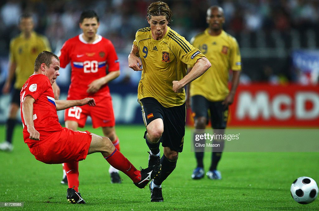 Aleksandr Anyukov of Russia (L) and Fernando Torres of Spain fight for the ball during the UEFA EURO 2008 Semi Final match between Russia and Spain at Ernst Happel Stadion on June 26, 2008 in Vienna, Austria.
